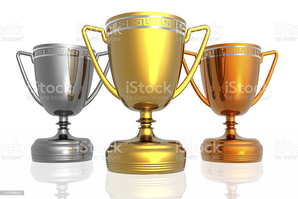 golden, silver, and bronze trophies stock photo