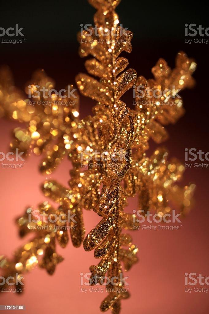 Golden Snowflake on Rosy Background stock photo