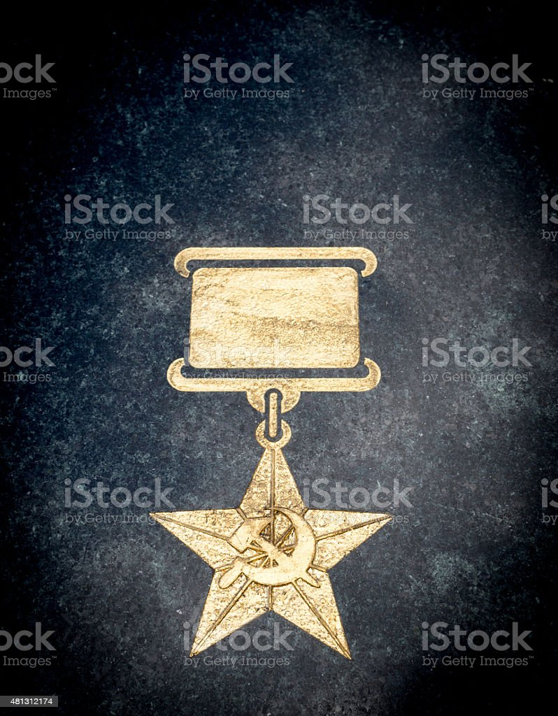 Golden Soviet Star Medal on Stone stock photo