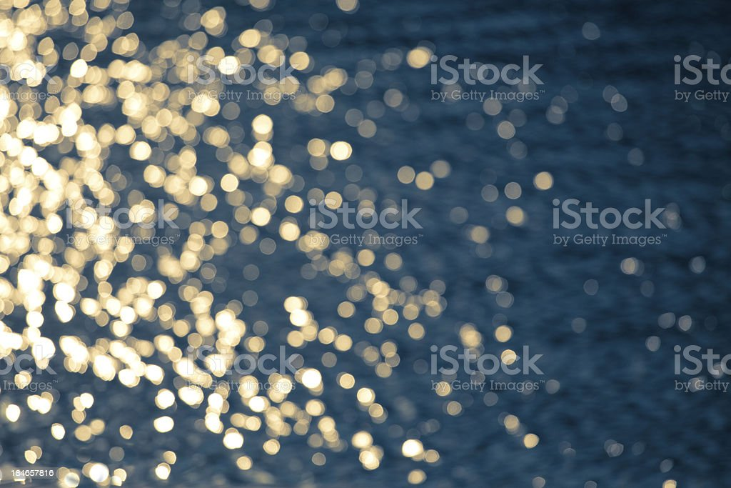 Golden sparkles on water royalty-free stock photo