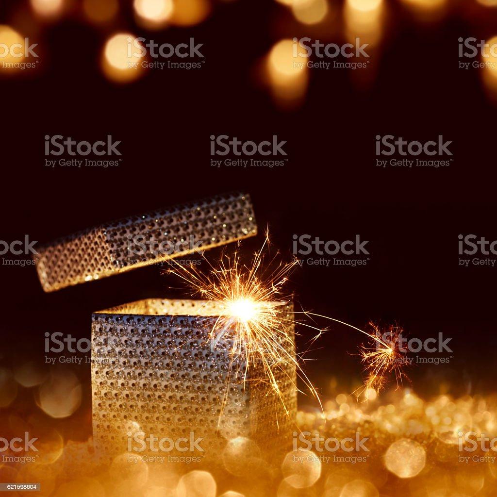 Golden sparkling surprise gift stock photo