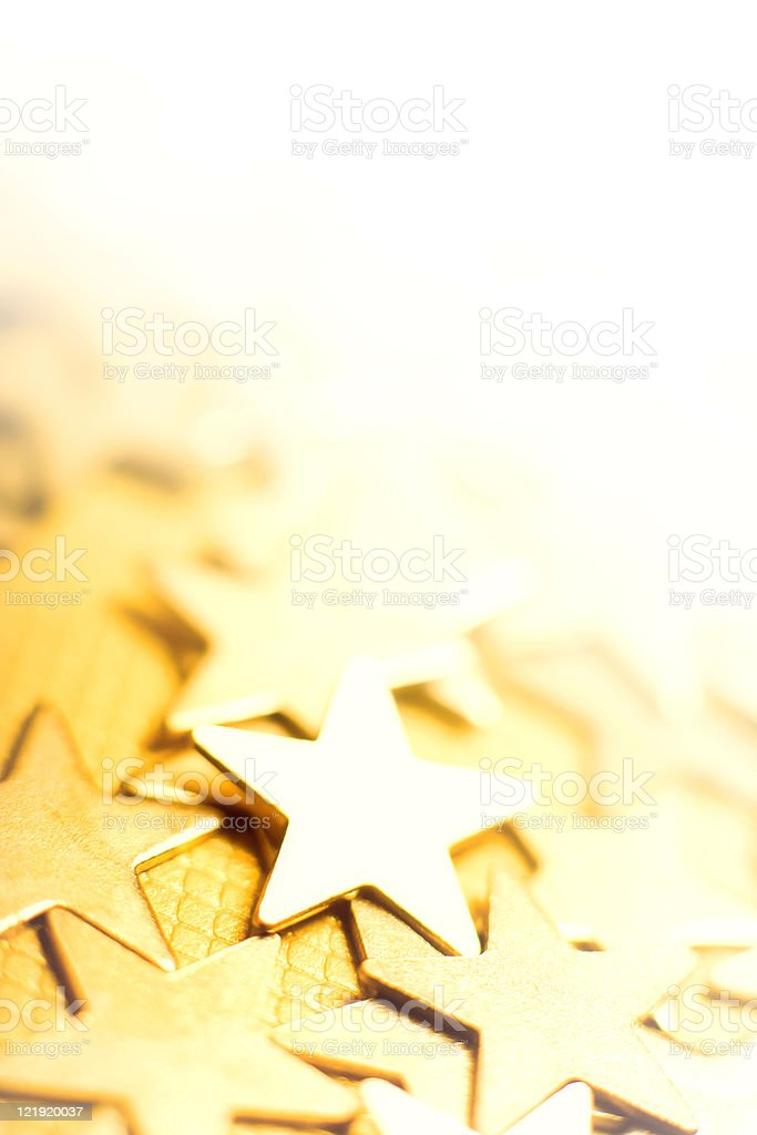 Golden stars in bright background stock photo
