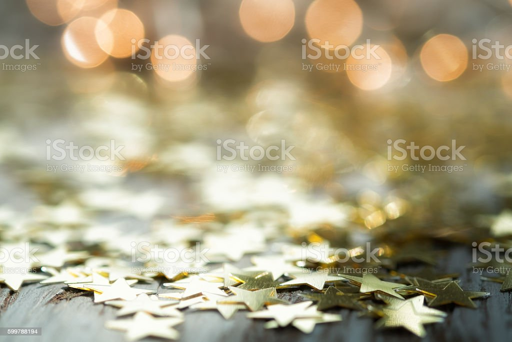 Golden stars on wood stock photo