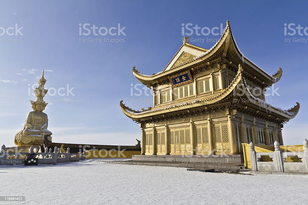 Golden statue and temple on the hill stock photo