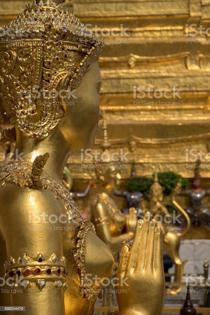 Golden statue at Wat Phra Kaew, Royal Place, Bangkok stock photo