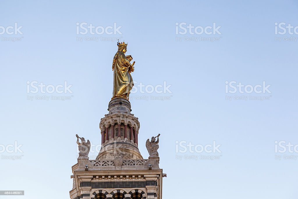 Golden Statue of Madonna Holding the little Jesus royalty-free stock photo