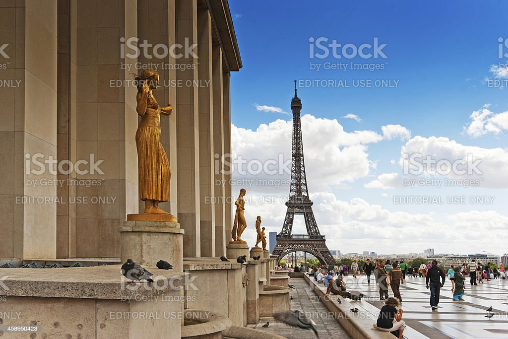 Golden statues and Eiffel tower in the background stock photo