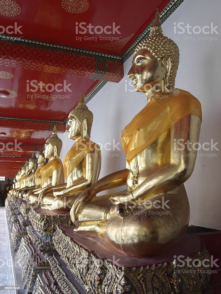 Golden Statues in a Buddhist Temple royalty-free stock photo