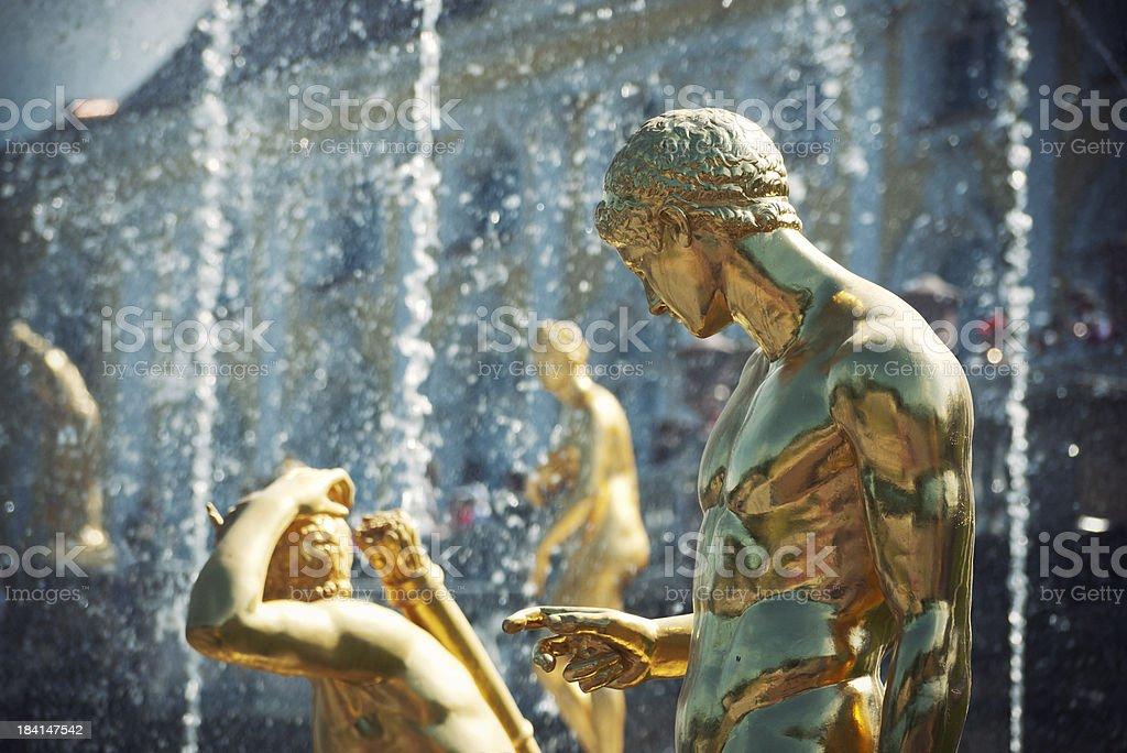 Golden statues in Peterhof stock photo