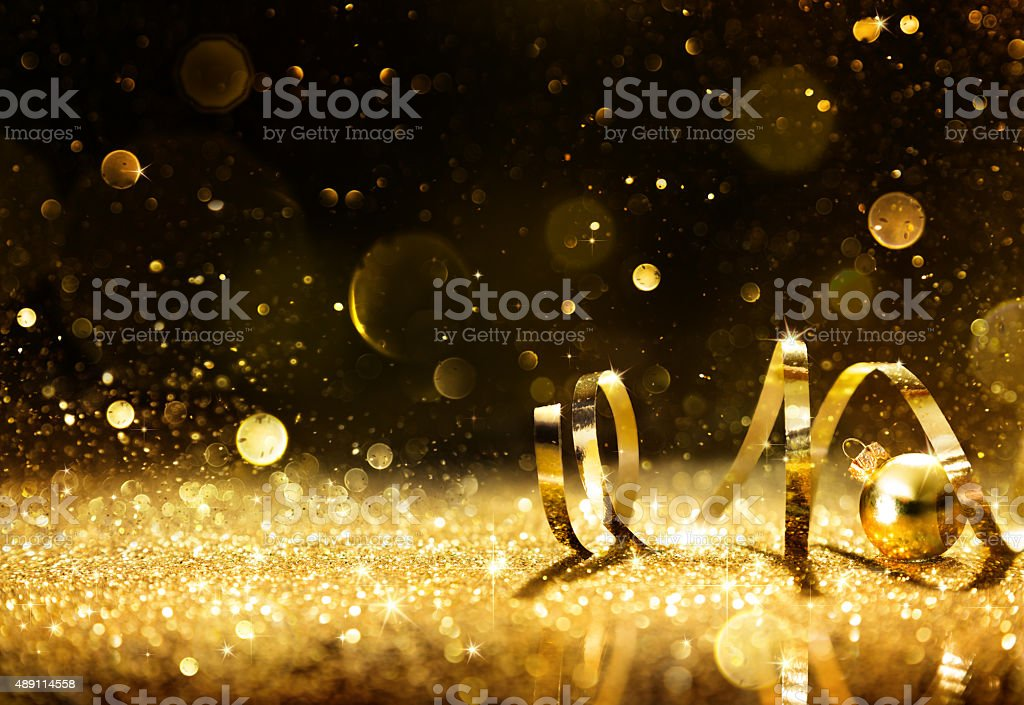 Golden streamers with sparkling glitter stock photo