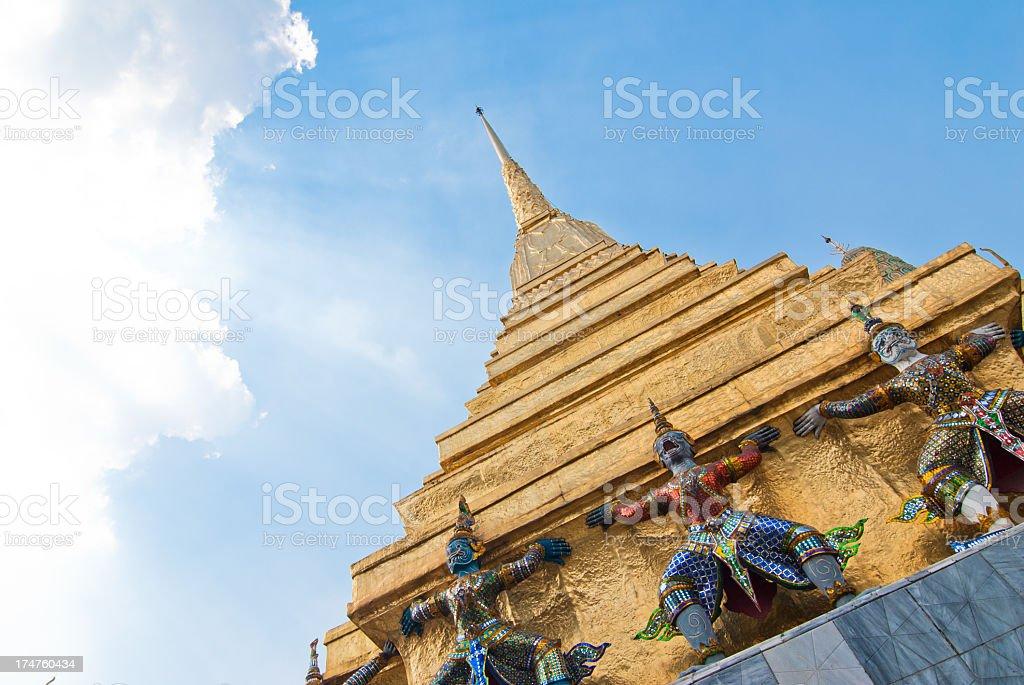 Golden Stupa and Ramayana figures royalty-free stock photo