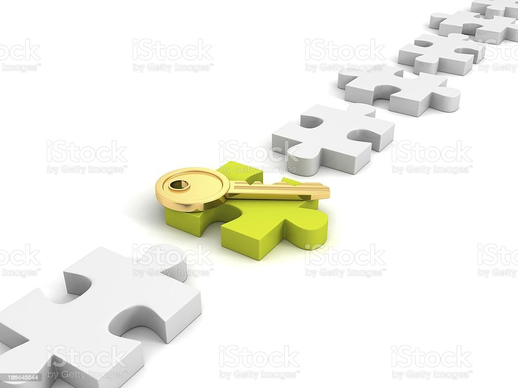 golden success key on green Jigsaw puzzle royalty-free stock photo