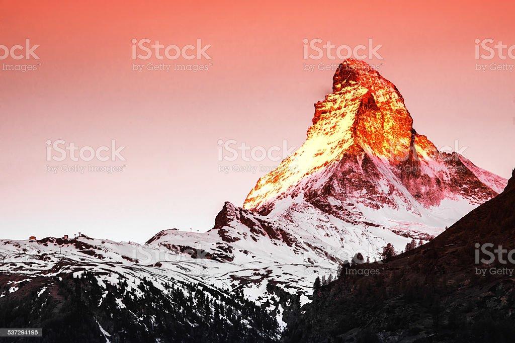 Golden sunlight shine on Matterhorn in early morning stock photo