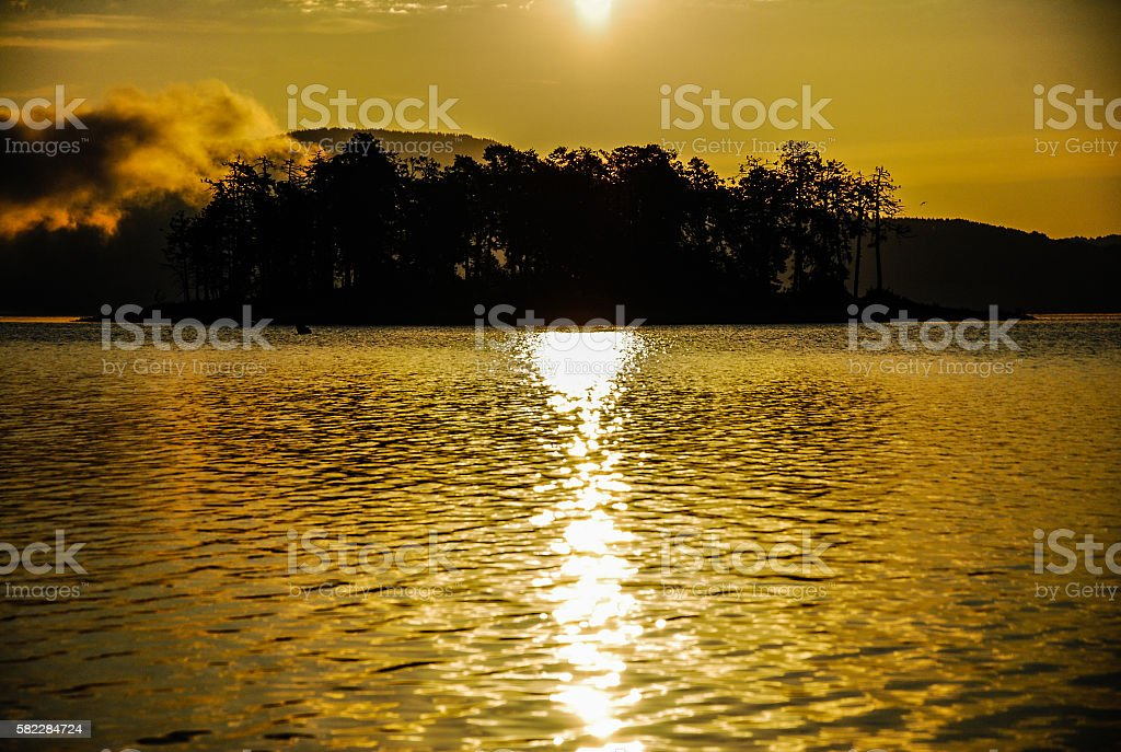 Golden sunrise above an iceland in a mountain dam stock photo