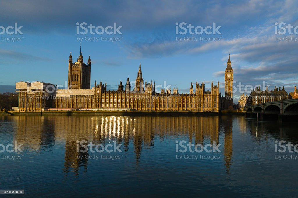 Golden sunrise glow illuminates the Houses of Parliament, Westminster, London stock photo