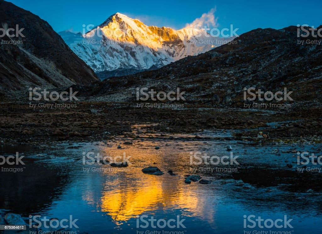 Golden sunrise on Cho Oyu 8188m Himalayan mountain summit Nepal stock photo