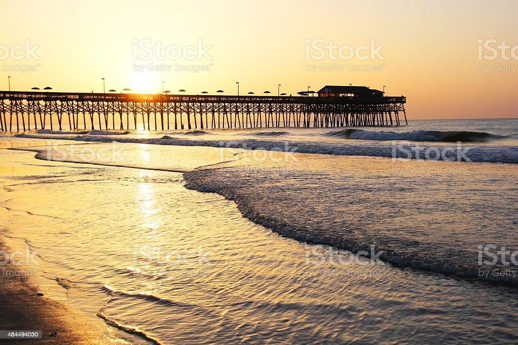 Golden sunrise over Atlantic ocean stock photo