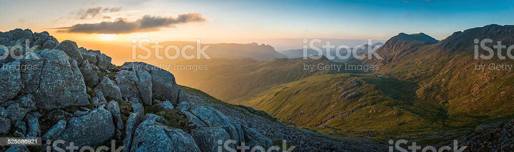 Golden sunrise over idyllic mountain valleys Lake District panorama Cumbria stock photo