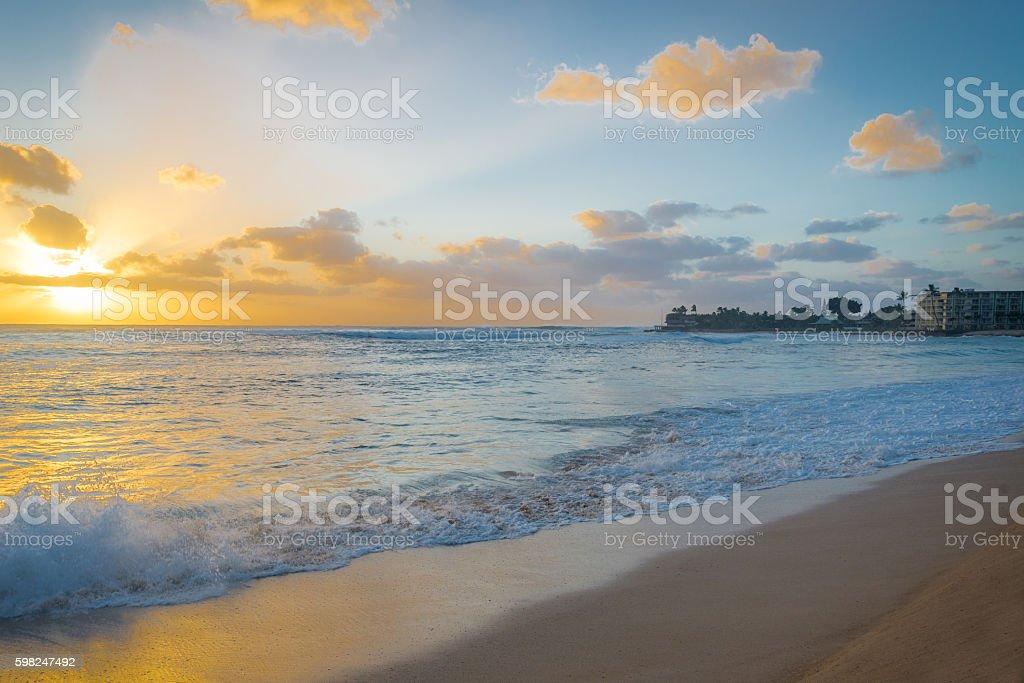 Golden sunset and a crashing wave stock photo