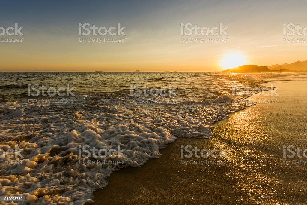 Golden Sunset at Empty Beach stock photo