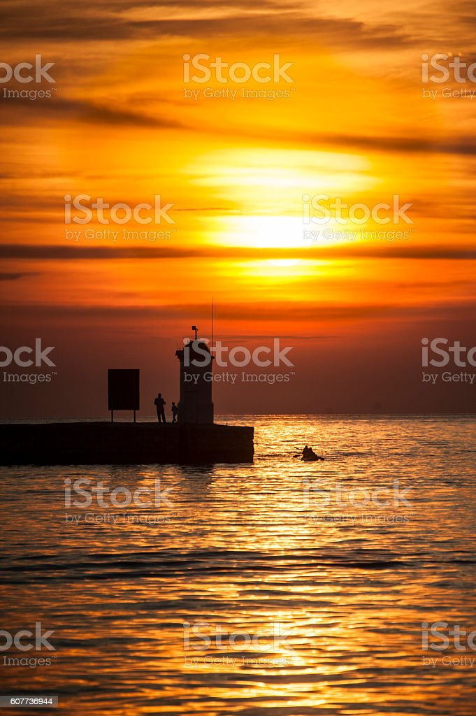 Golden Sunset at Lighthouse in Croatia stock photo
