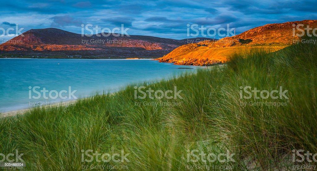Golden sunset light on ocean beach sand dunes Highlands Scotland stock photo