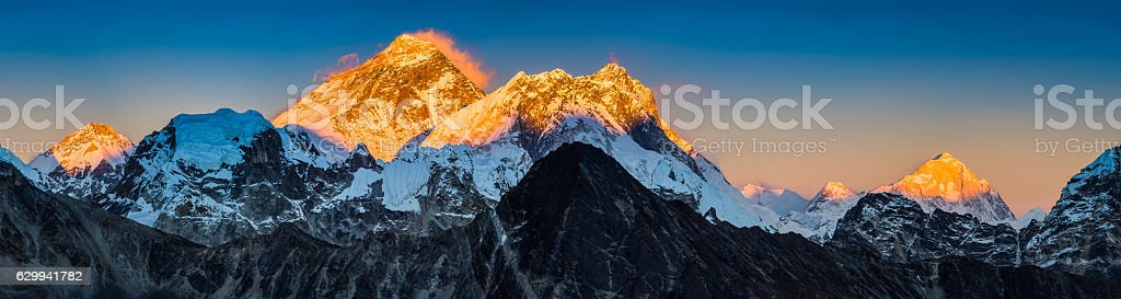 Golden sunset on Mt Everest summit Himalaya mountains peaks panorama stock photo