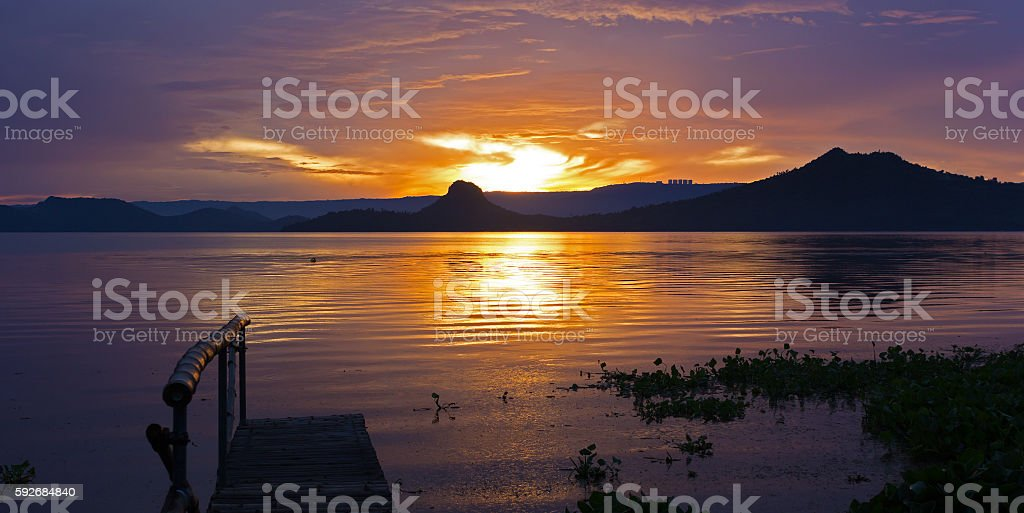 Golden sunset on the Lake Taal, Philippines. stock photo