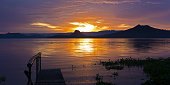 Golden sunset on the Lake Taal, Philippines.