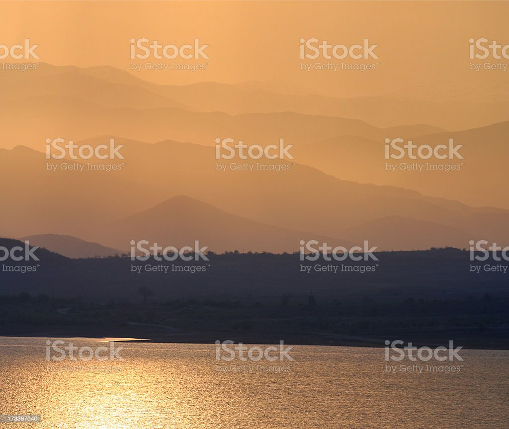 Golden sunset over a mountain lake royalty-free stock photo