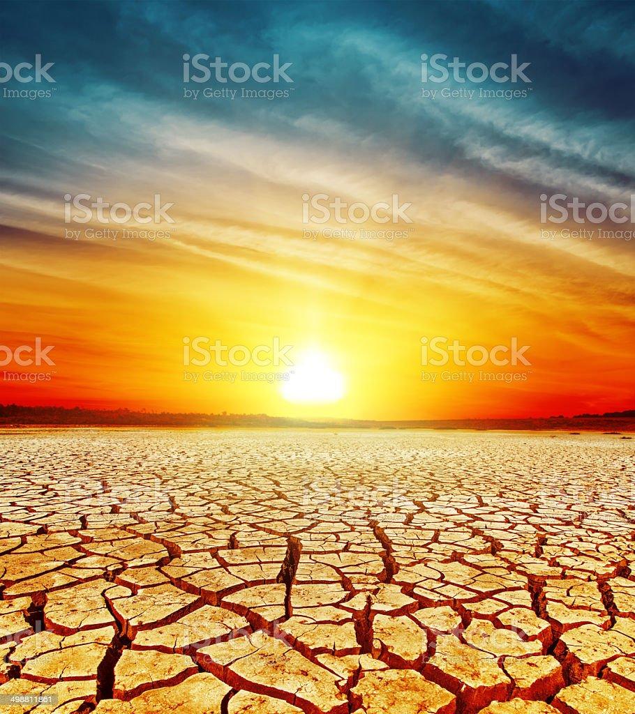 golden sunset over cracked desert stock photo