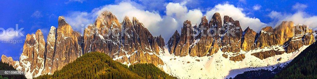 Golden sunset over impressive Dolomites rocks. Italy stock photo