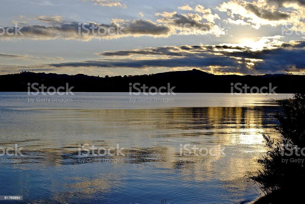 Golden sunset over  lake Taupo,New Zealand royalty-free stock photo