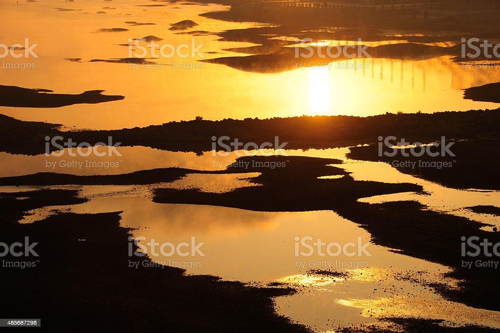 Golden sunset over river stock photo