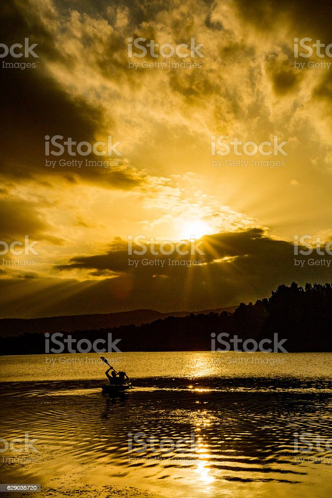 Golden Sunset Paddlers stock photo