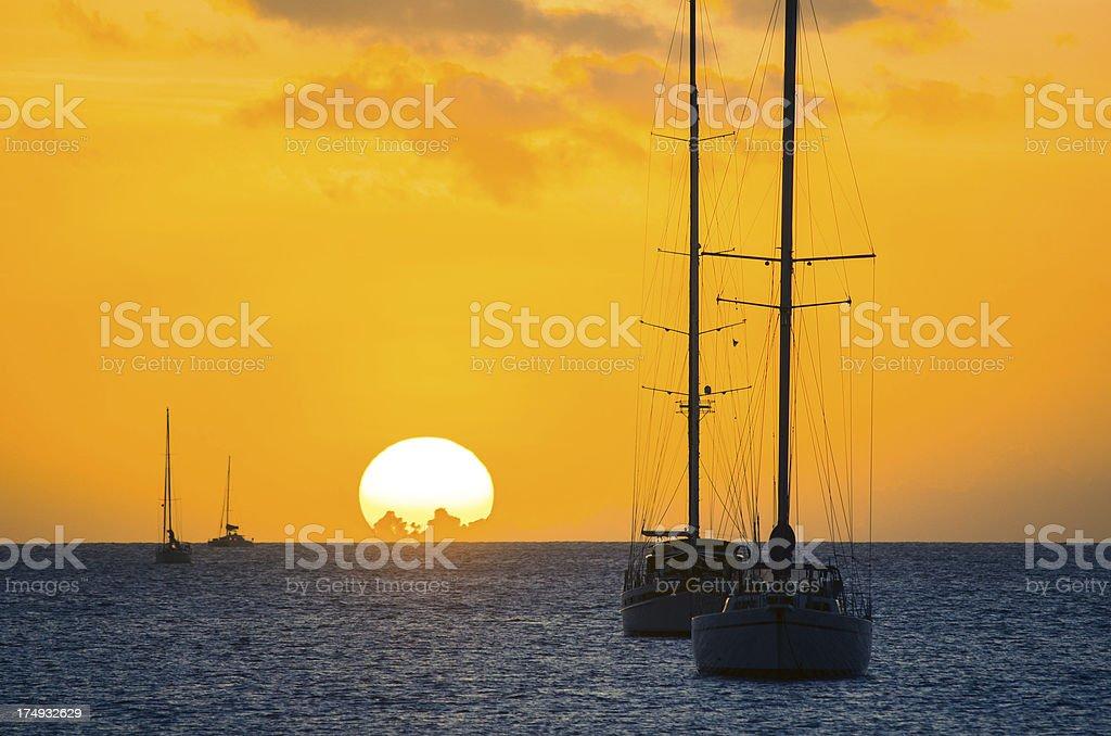 golden sunset paradise and sailboats royalty-free stock photo