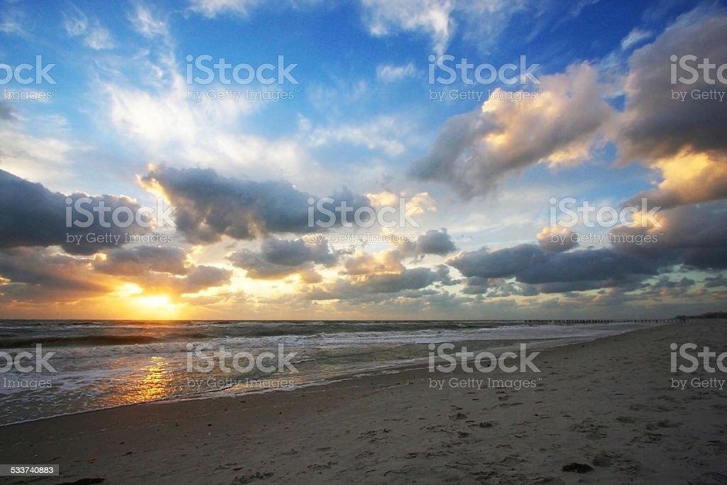 Golden sunset rays over ocean stock photo