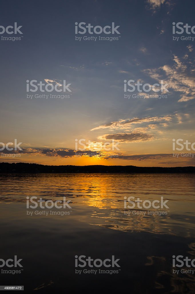 Golden sunset reflections in lake stock photo