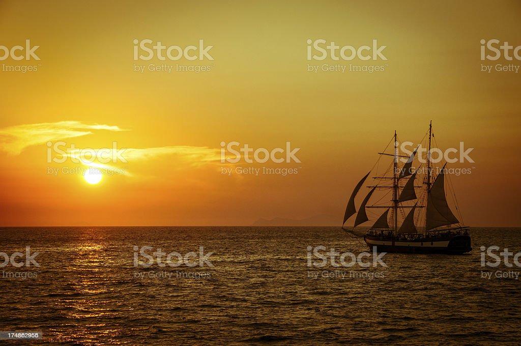 Golden Sunset Sail on the Caldera, Santorini, Greece royalty-free stock photo