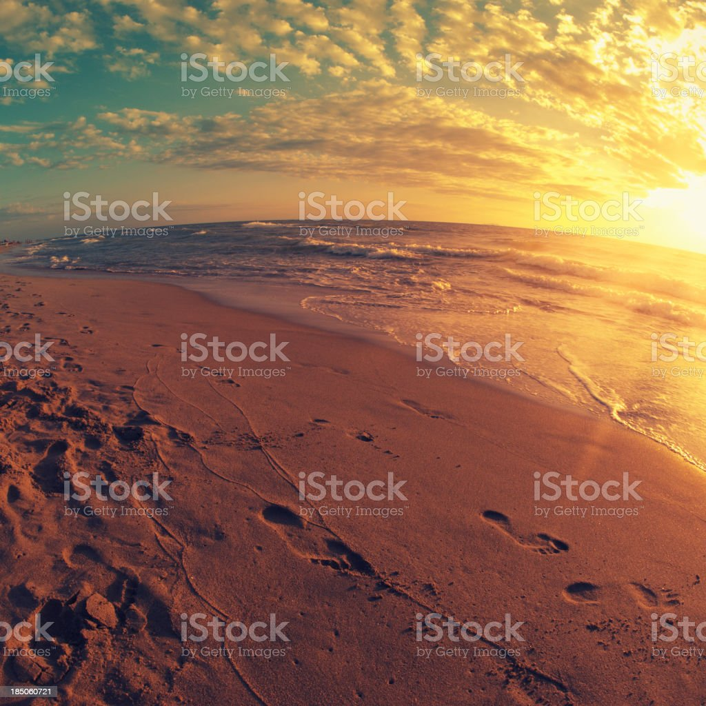 Golden Sunset Sea with dramatic sky royalty-free stock photo