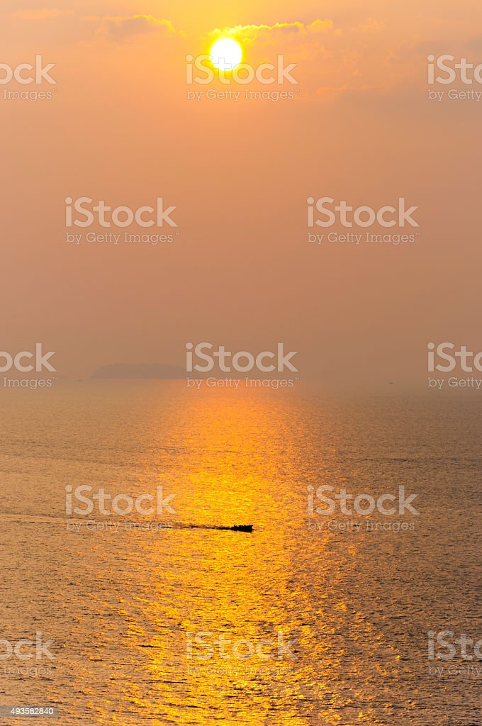 Golden sunset sun on Arabian sea in Murudeshwar, Karnataka, India. stock photo