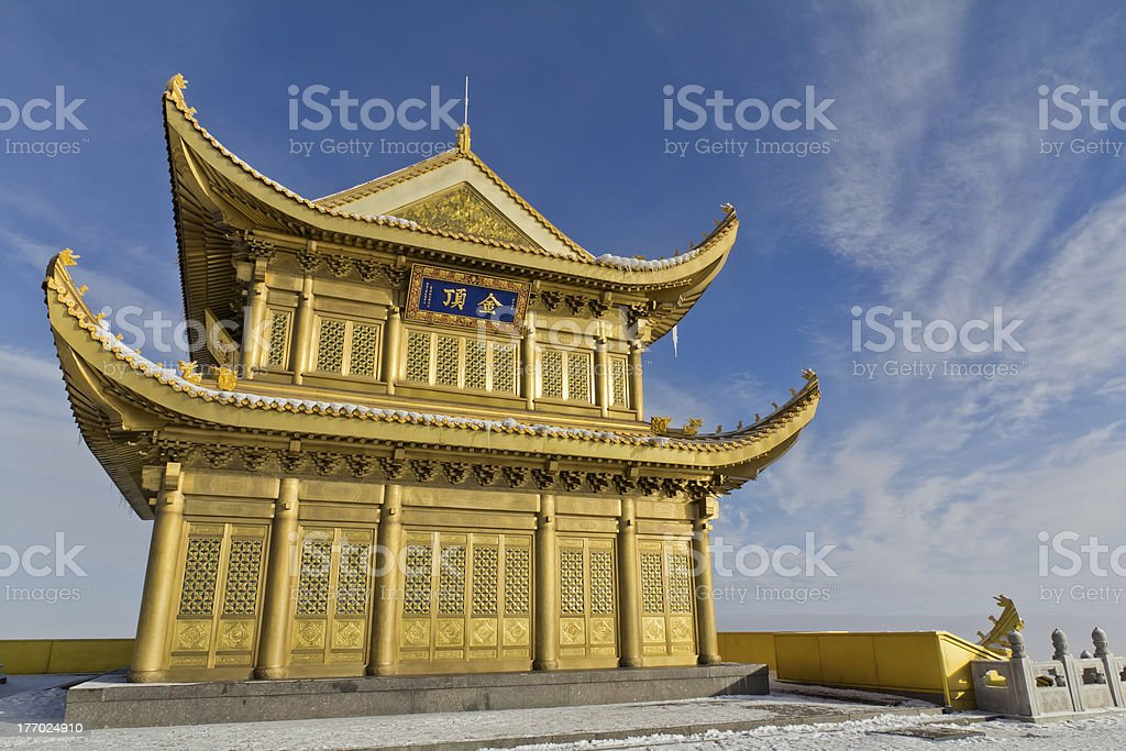 Golden temple on the top of mountain stock photo