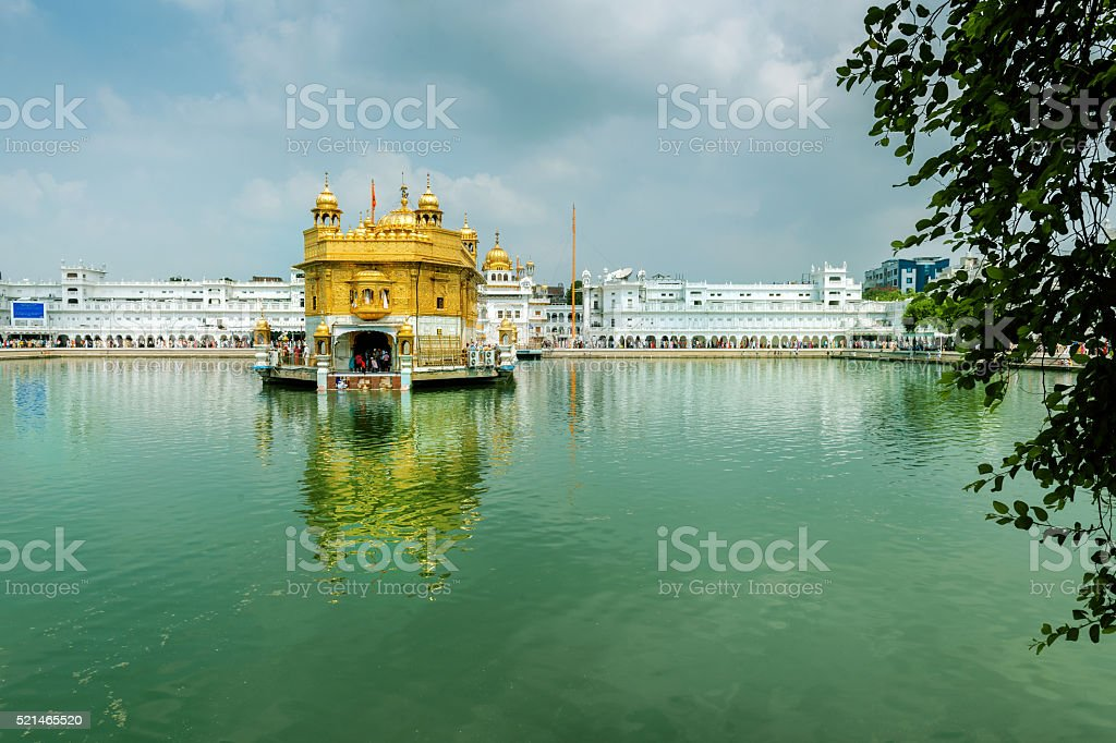 Golden temple Reflecting in Water Amritsar,India stock photo