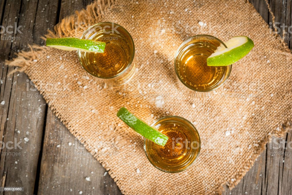 Golden tequila with lime stock photo