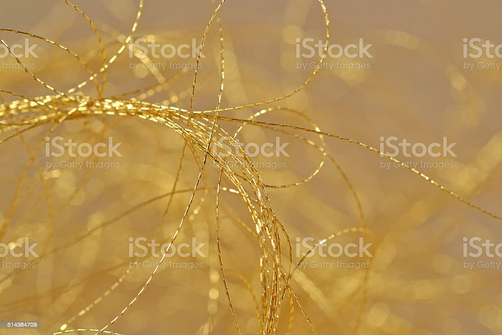 Golden threads close-us selective focus stock photo