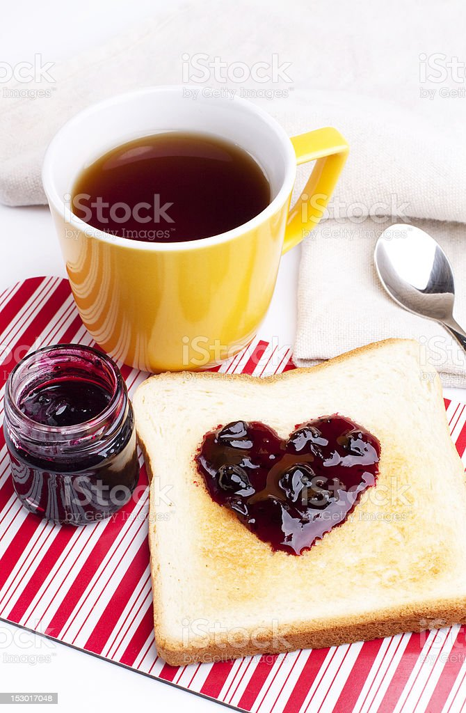 Golden toast with heart shaped currant jam royalty-free stock photo