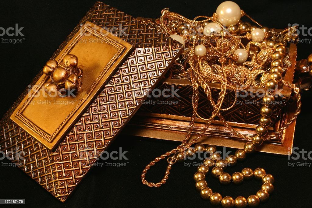 Golden Treasure Chest with gold and pearl jewelry royalty-free stock photo