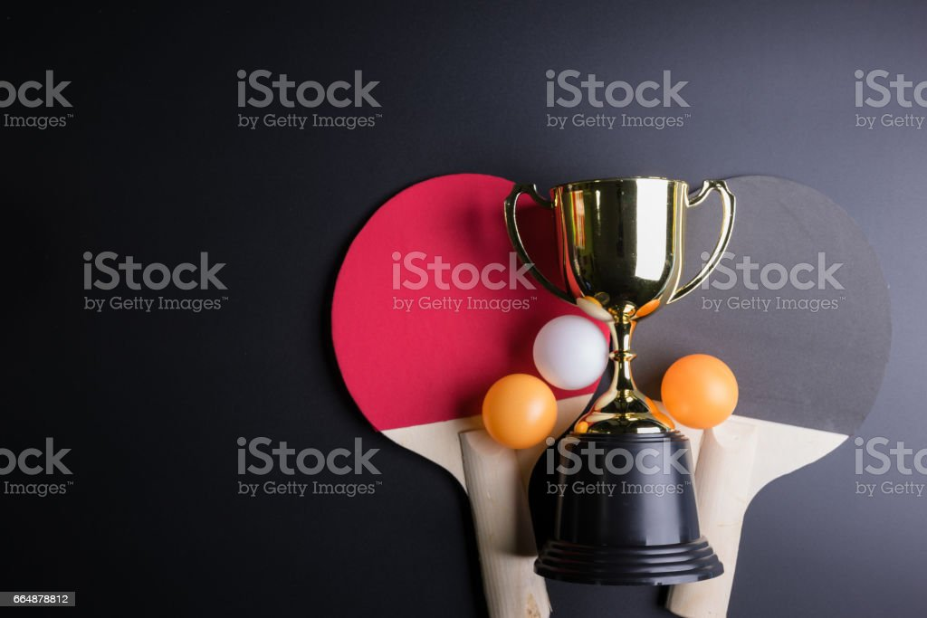 Golden trophy, Racket table tennis with ping pong ball on black background.Sport concept, Concept winner, Copy space image for your text. stock photo