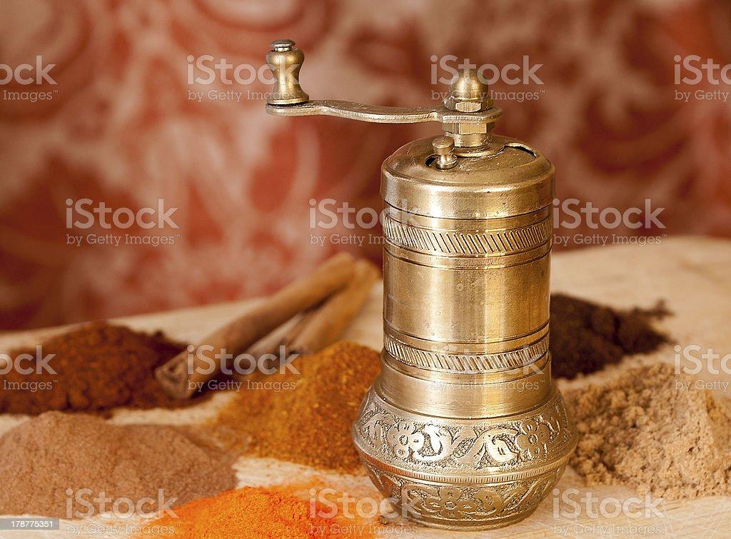 Golden Turkish spice mill stock photo