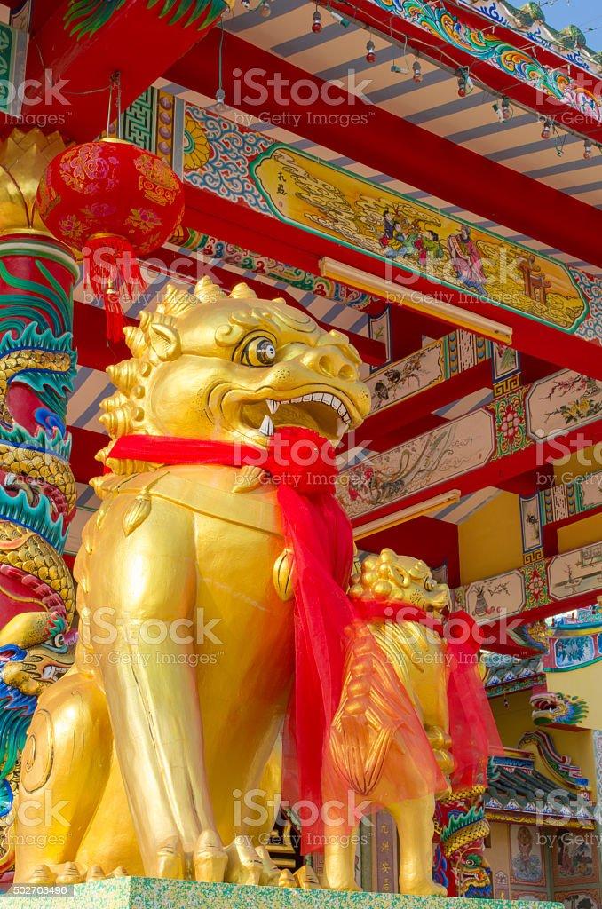 golden twin kirin sculpture stock photo